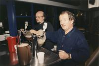 [Staff members?] pull pitchers of beer, circa 1990s.